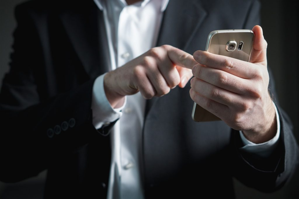 Thoughtless writing finger and smartphone