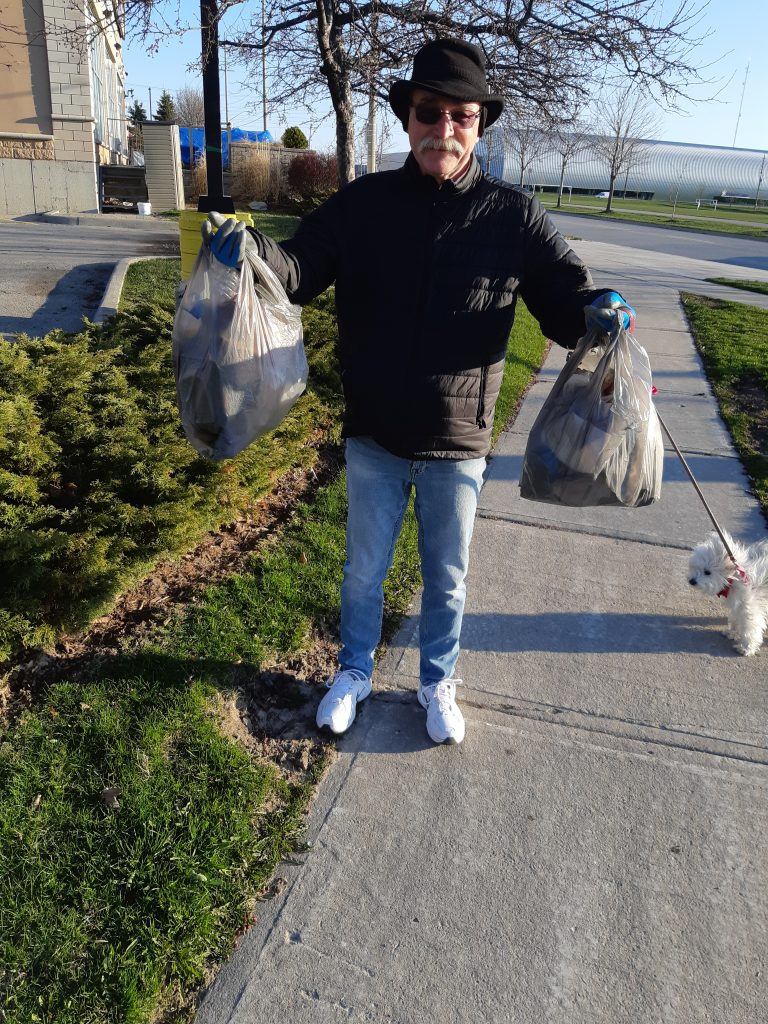 Dan and Princess Sophie Mophie Defender of the Universe showing litter picked up in 500m in Whitby Shores, Ontario.